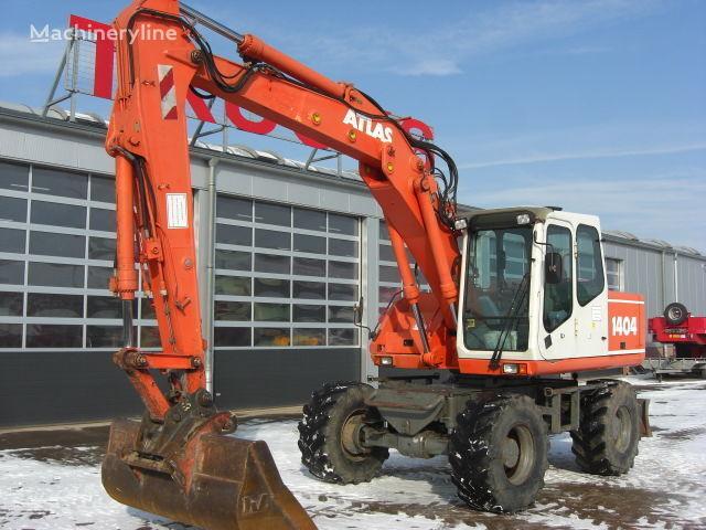 escavatore gommato ATLAS 1404